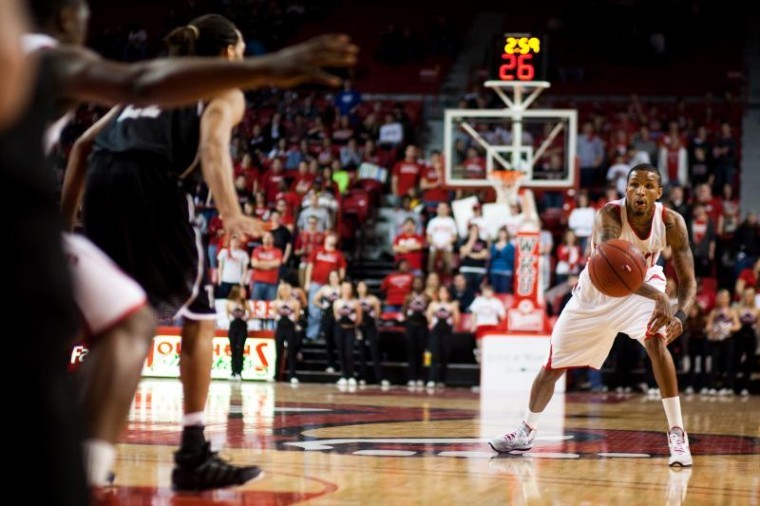 Senior Cliff Dixon passes the ball during Saturday night's game against Troy. Dixon grabbed seven rebounds off the bench, helping WKU pick up a 77-58 win.