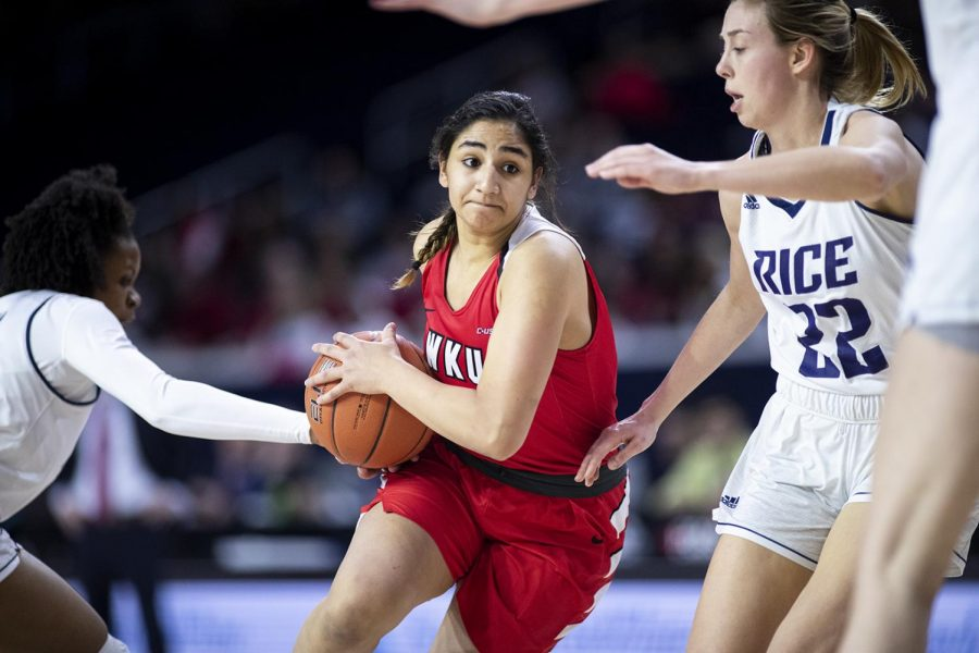 WKU freshman guard Meral Abdelgawad (30) drives into the paint against Nicole Iademarco (22) and a stingy Rice defense in the C-USA quarterfinal round at the Ford Center at The Star March 15 in Frisco, Texas. Abdelgawad only scored 5 points and had 3 rebounds in 21 minutes of play in the 64-57 loss. [HERALD/ Jospeh Barkoff]