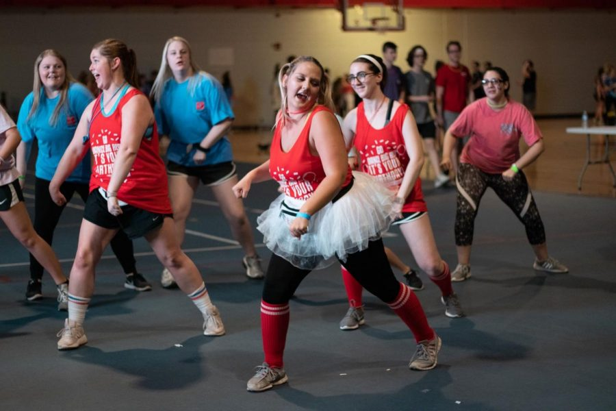 Riley+Ball+leads+a+group+of+friends+at+the+annual+Dance+Big+Red+event%2C+in+Preston+Center+on+March+30%2C+2019.