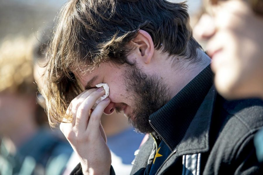 WKU international affairs and history major Daniel Candee gets emotional while other attendants of the vigil read the names of the victims at Centennial Mall on Friday, March 22.