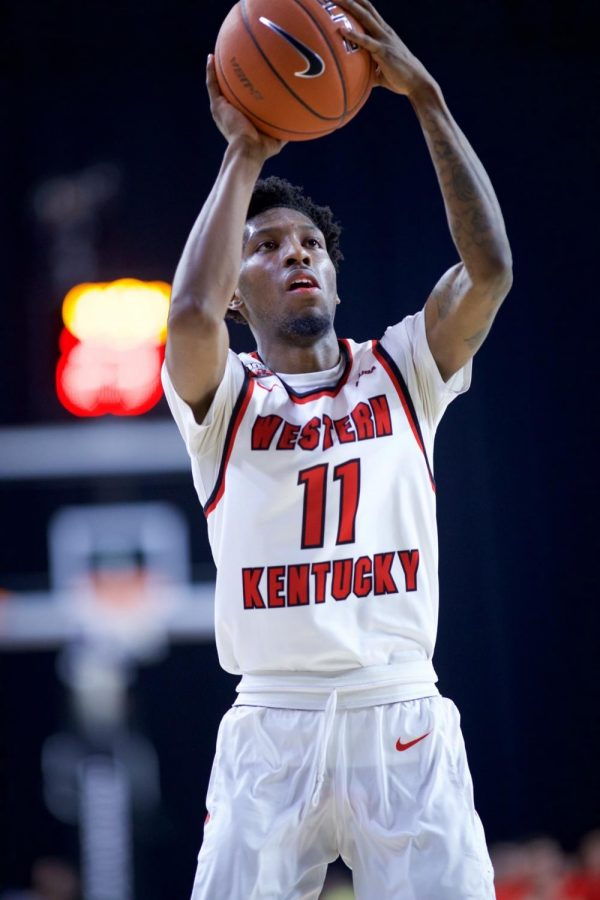 WKU+guard+Taveion+Hollingsworth+%2811%29+takes+a+shot+against+North+Texas+at+the+Ford+Center+at+The+Star+March+14+in+Frisco%2C+Texas.+Hollingsworth+scored+23+points+and+snagged+3+rebounds+and+1+assist+in+36+minutes+during+the+Hilltoppers%E2%80%98+%C2%A0win.