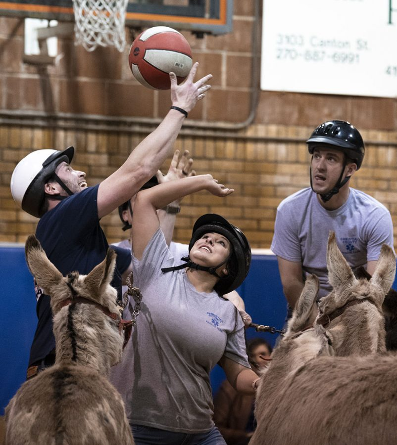 Lori Bethfooshee reaches for the basketball during the donkey basketball game in Pembroke, Ky. on Saturday, March 2, 2019.