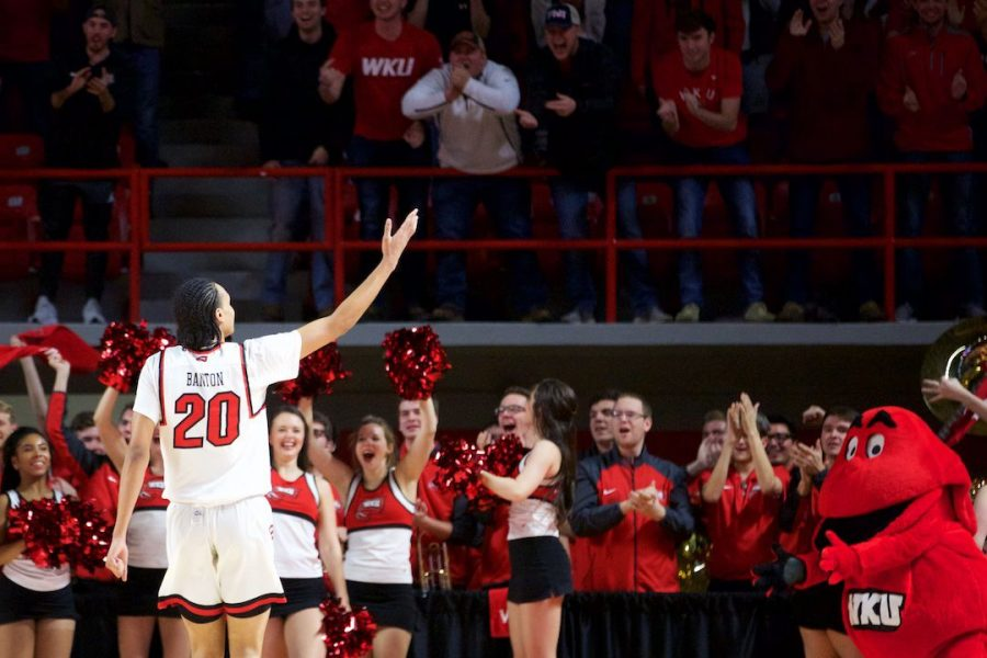 WKUs Dalano Banton (20) waves to the fans in Diddle Arena Dec. 29 in Bowling Green. Banton had eight points, 13 rebounds and 10 assists in the Hilltoppers win over Wisconsin.