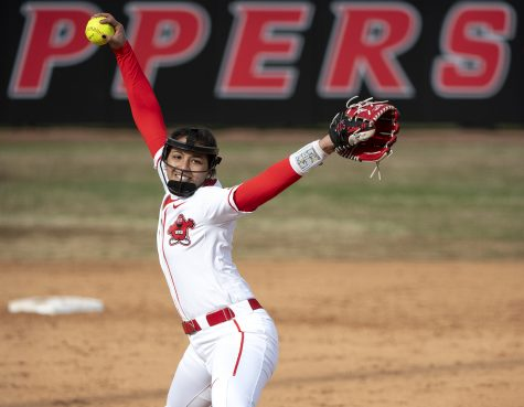 Freshman Kennedy Sullivan throws a pitch during WKU's win 5 to 3 over WIU in Bowling Green on Saturday, Feb. 16, 2019.
