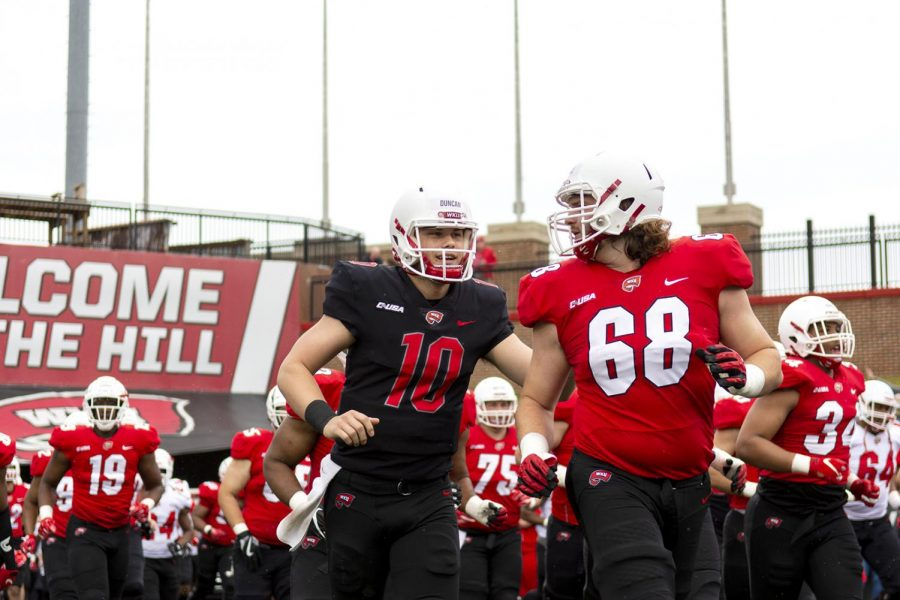 WKU+quarterback+Steven+Duncan+%2810%29+talks+with+offensive+lineman+Parker+Howell+%2868%29+as+they+run+out+of+the+tunnel+before+the+Red+vs+White+Spring+game+on+April+13.+The+Red+team+came+up+short+to+the+White+team%2C+losing+28-21.