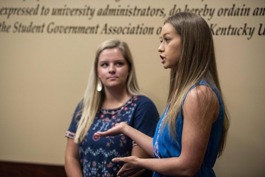 Amanda Harder, left, and Mary Fyfe, right, speak about a resolution they authored a to add a five dollar fee to student tuition to support the College Heights Herald. The resolution was debated but ultimately voted on and passed during a meeting in Senate Chambers on April 23, 2019.
