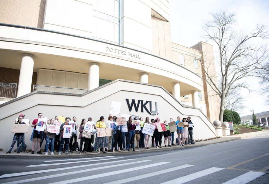 """Protesters sing freedom songs and chant """"we want the truth"""" and """"stand with Snyder"""" in front of the Wetherby Administration Building on Thursday, March 28, 2019. Two days earlier Larry Snyder resigned from his position as dean of Potter College."""