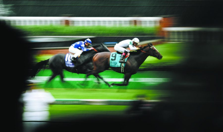 Two horses race to the finish during a turf race on May 5, 2018, at the 144th Kentucky Derby in Louisville.