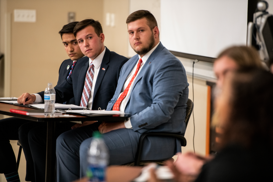 SGA executive candidates (left to right) Kenan Mujkanovic, Garrett Edmonds and Will Harris watch as their opponents speak during the Herald Town Hall on April 10, 2019 in Gary Ransdell Hall. Herald Town Hall is a forum for candidates to answer questions regarding their campaign submitted by the WKU student body, faculty and staff.