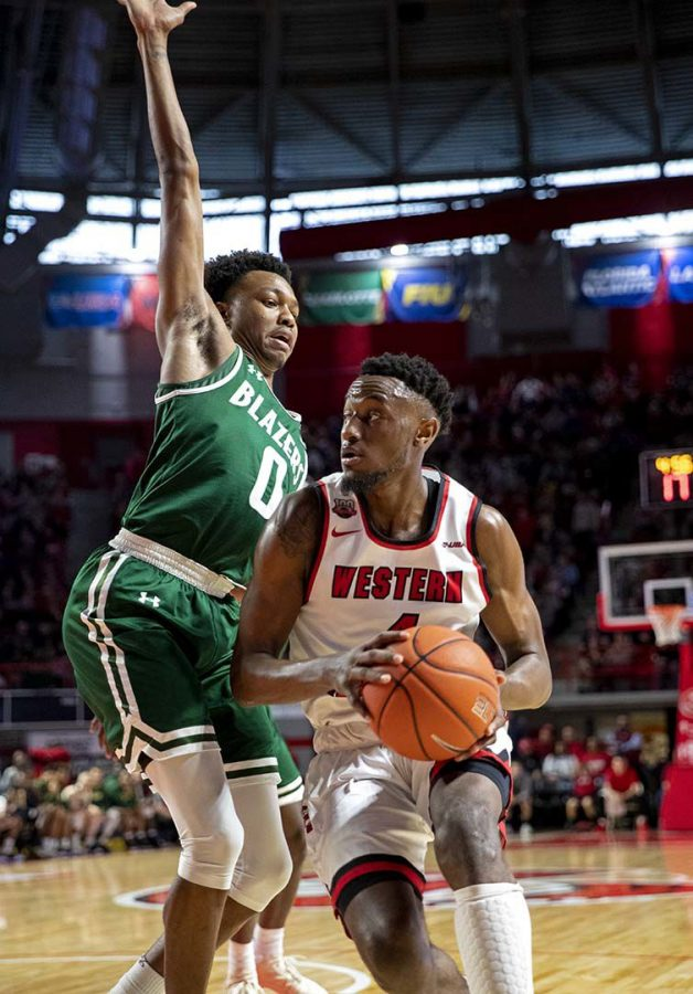 Hilltopper+guard+Josh+Anderson+looks+to+drive+the+baseline+past+an+overextended+UAB+Blazer+Tyreek+Scott-Grayson+on+Feb.+16+at+E.A.+Diddle+Arena.+Anderson+scored+15+in+the+68-60+loss.