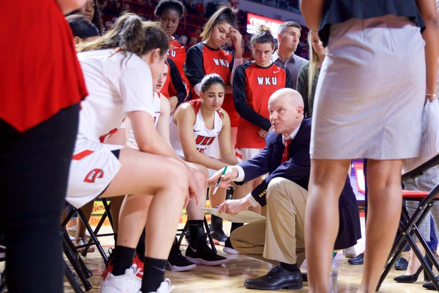 Lady Toppers' head coach Greg Collins instructs the team during their 75-60 win over Old Dominion on Saturday at Diddle Arena.