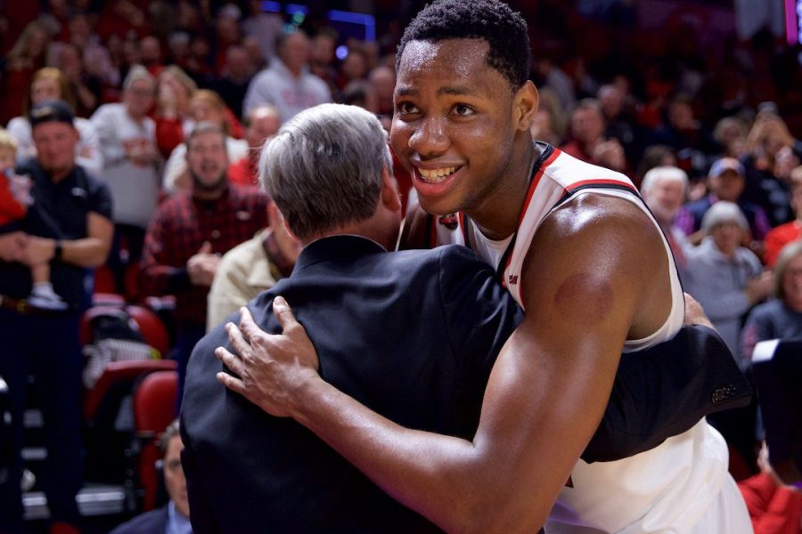 Charles Bassey (23) embraces head coach Rick Stansbury after defeating 15th-ranked Wisconsin in Diddle Arena Dec. 29 in Bowling Green. Bassey had 19 points and six rebounds in the win.