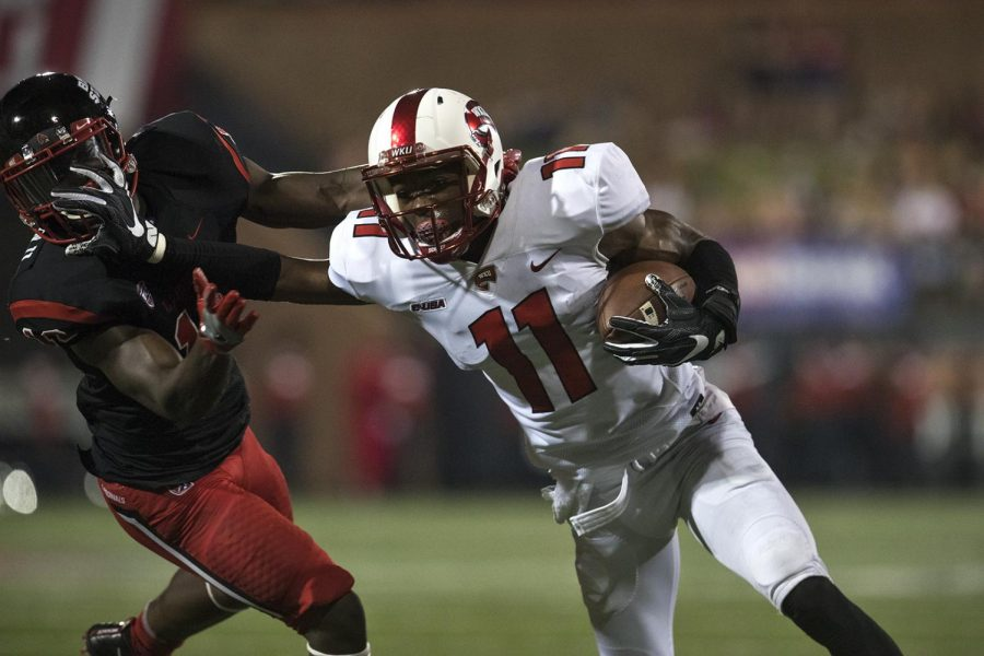 WKU Wide receiver Lucky Jackson (11) stiff arms Ball State cornerback Lamar Anderson (10) during the Hilltoppers 33-21 win over Ball State on Saturday September 23, 2017 at Houchens-Smith Stadium.