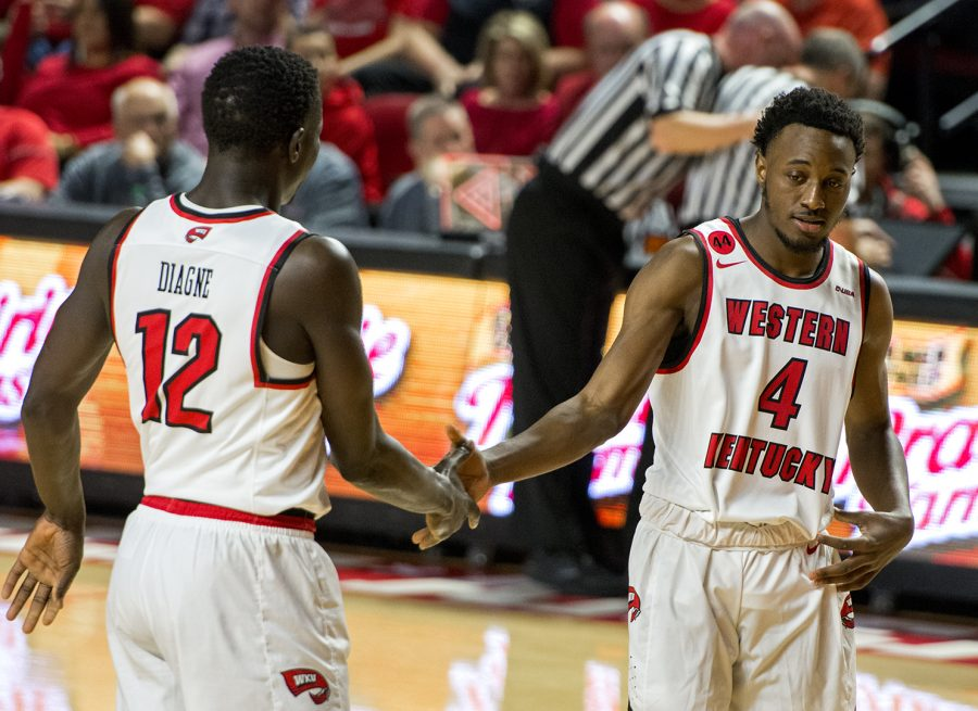 WKU+forward+Moustapha+Diagne+%2812%29+gives+good+luck+to+WKU+guard+Josh+Anderson+%284%29+at+the+free+throw+line+during+the+game+against+Marshall+on+Saturday%2C+Jan.+27+in+E.A.+Diddle+Arena.+In+Anderson%27s+10+minutes+of+playing+time%2C+he+totaled+four+points+including+a+dunk+in+the+first+half.+The+Hilltoppers+won+the+game+85-74.