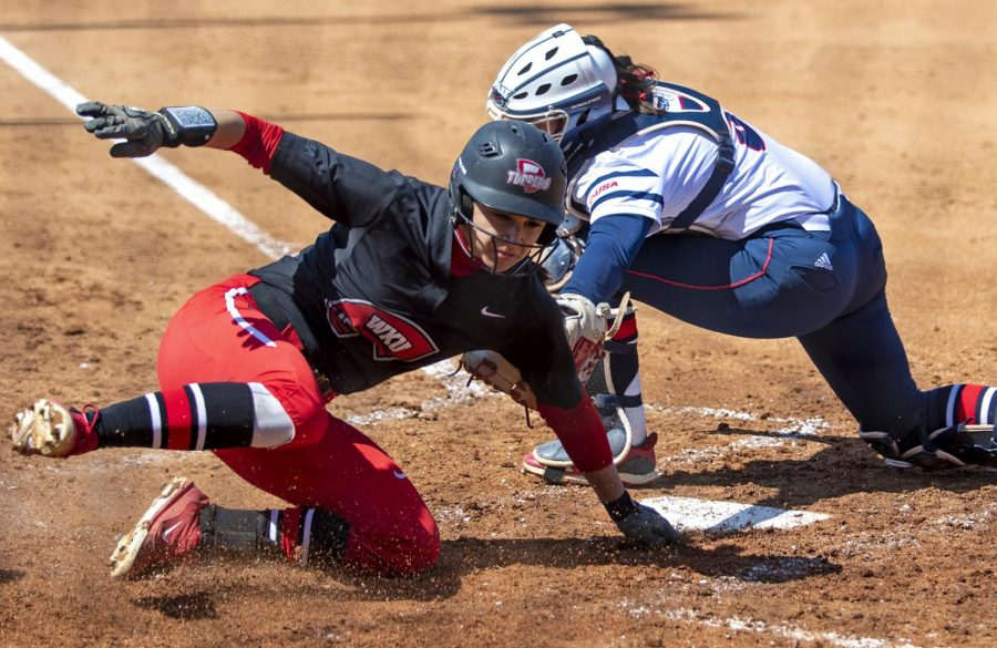 Kendall Smith slides into home during game against Florida Atlantic on Sunday, March 31, 2019. WKU won the game with a final score of 10-2.