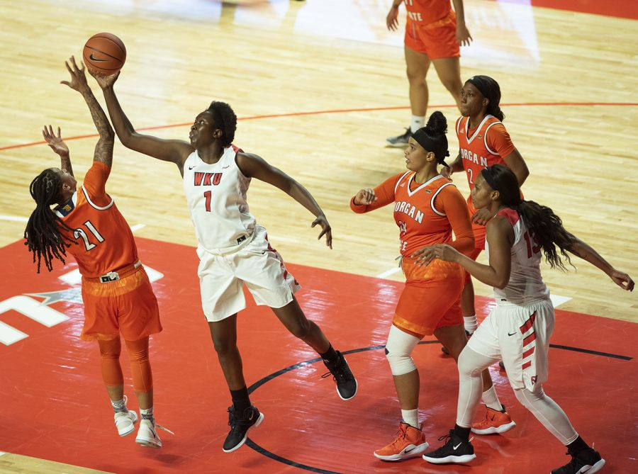 Lady+Toppers%E2%80%99+Arame+Niang+%281%29+swats+the+ball+away+from+Morgan+State%E2%80%99s+Adre%E2%80%99onia+Coleman+%2821%29+in+the+Hilltoppers%E2%80%99+90-43+win+against+the+Bears+on+Wednesday+at+Diddle+Arena.+Niang+earned+her+first+double-double+as+a+Hilltopper+in+the+win.
