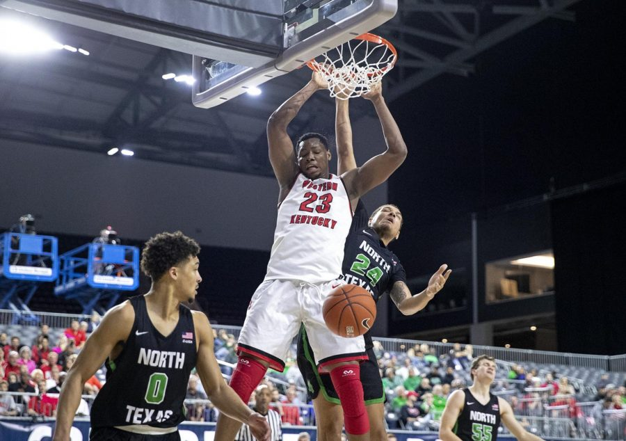 WKU freshman center Charles Bassey (23) slams home a dunk over North Texas Zachary Thomas (24) in day two of the C-USA Tournament at the Ford Center at The Star march 14 in Frisco, Texas. Bassey accumulated 9 points, 8 rebounds and 4 blocks in the 67-51 Hilltopper victory.