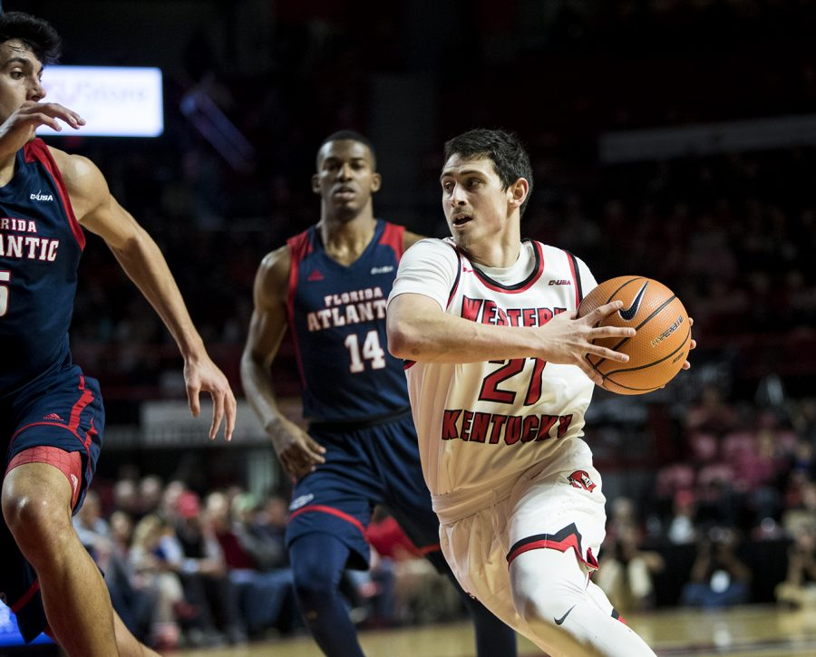Freshman+guard+Jake+Ohmer+%2821%29+dribbles+to+the+hoop+during+WKU%27s+game+vs.+Florida+Atlantic+in+E.A.+Diddle+Arena+on+Feb.+8.+WKU+beat+Florida+Atlantic+75-63.%C2%A0