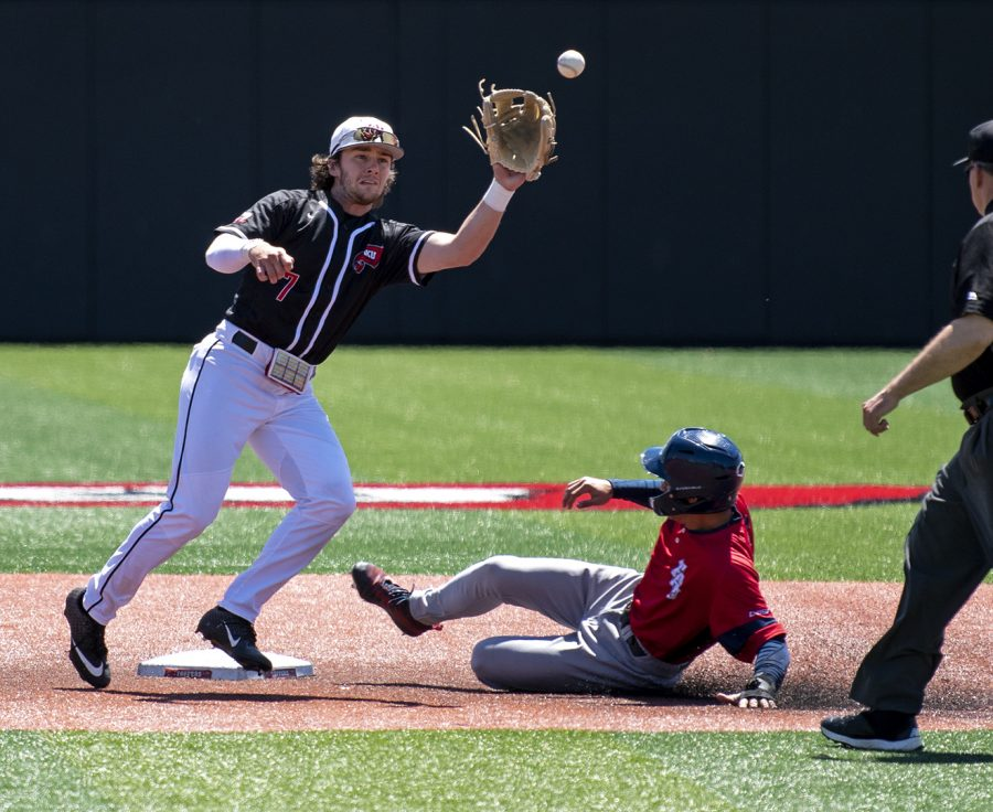 WKU's Nick Brunson catches a late throw to second base against FAU on Sunday. Brunson still tagged a career high three players out in the 6-4 loss to the Owls at Nick Denes Field.