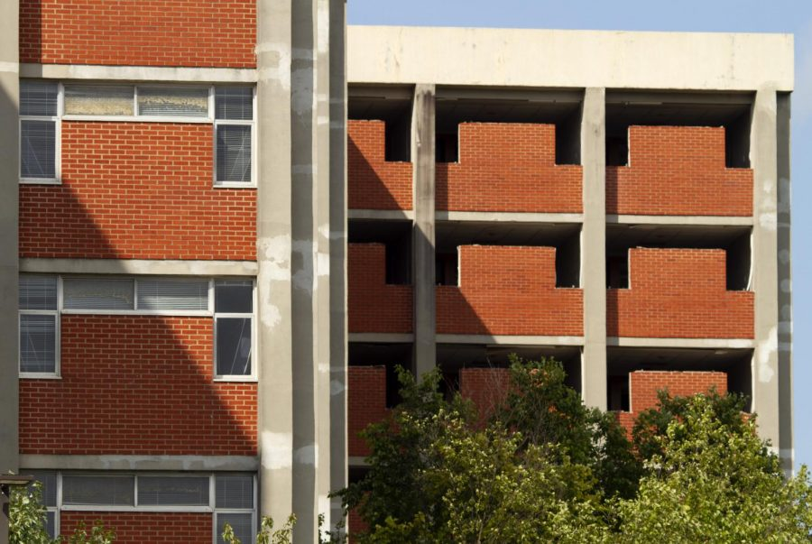 Crews have removed windows from Bemis Lawrence hall (rear) and are expected to complete demolition during fall 2019. Barnes Campbell hall (front) will remain standing during construction of the First Year Village and be demolish in fall 2021.