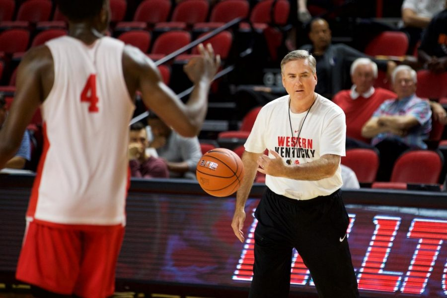 Head coach Rick Stansbury passes the ball to begin a drill while WKU hosts its first basketball pro day Thursday in Diddle Arena. Stansbury is entering into his third season as head coach at WKU.