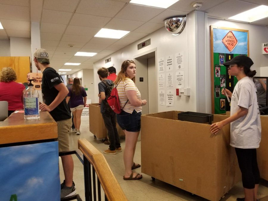 Students move into Rodes Harlin hall at the beginning of the Summer Scholars program, a transition program to help students get ready for college.