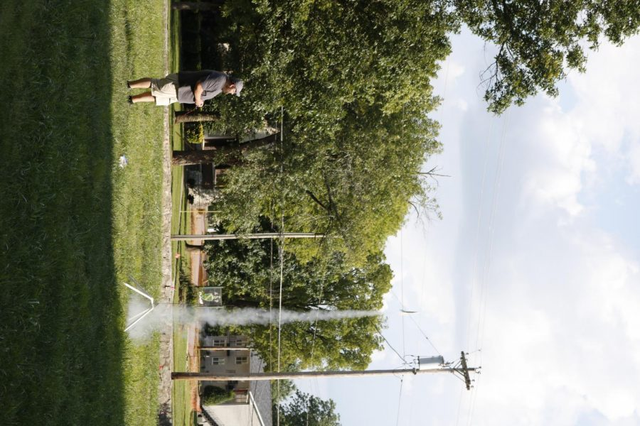 Ecil Miller, Drakes Creek Middle School science teacher, launches a model rocket on the lawn behind Snell Hall as a part of the Moon Landing Celebration.