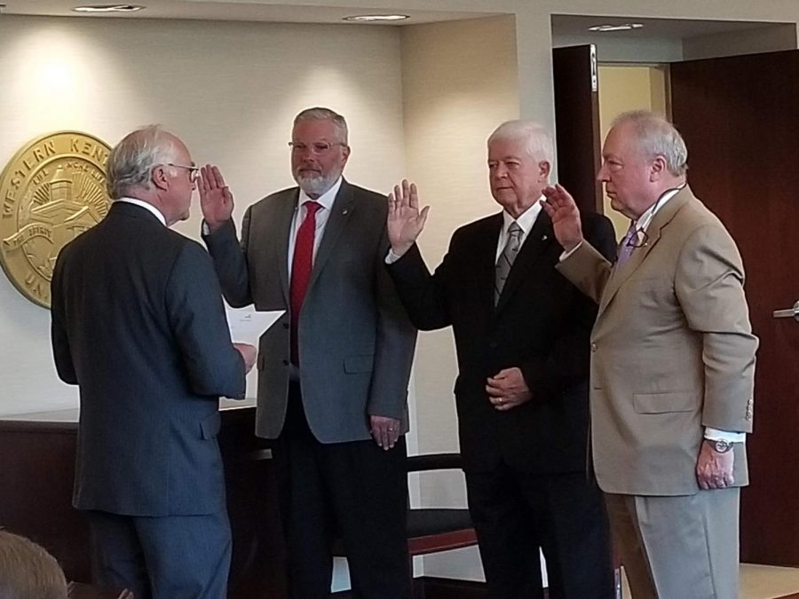 Former Regent Chair Phillip Bale swears in David Brinkley as new board secretary, Fredrick A. Higdon as new board vice chair, and Gillard B. Johnson III as new board chair at the third quarterly Board of Regents meeting.