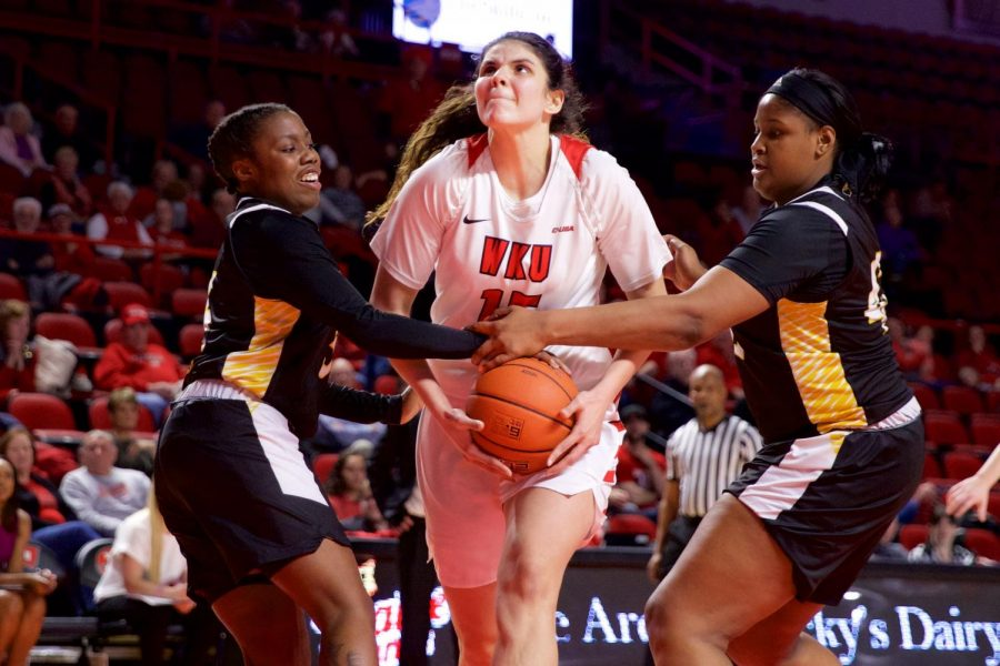 WKU's sophomore center Raneem Elgedawy drives to the hoop with two Southern Mississippi defenders holding hands to block her attempt in Diddle Arena on Jan. 24. HERALD/ Joseph Barkoff