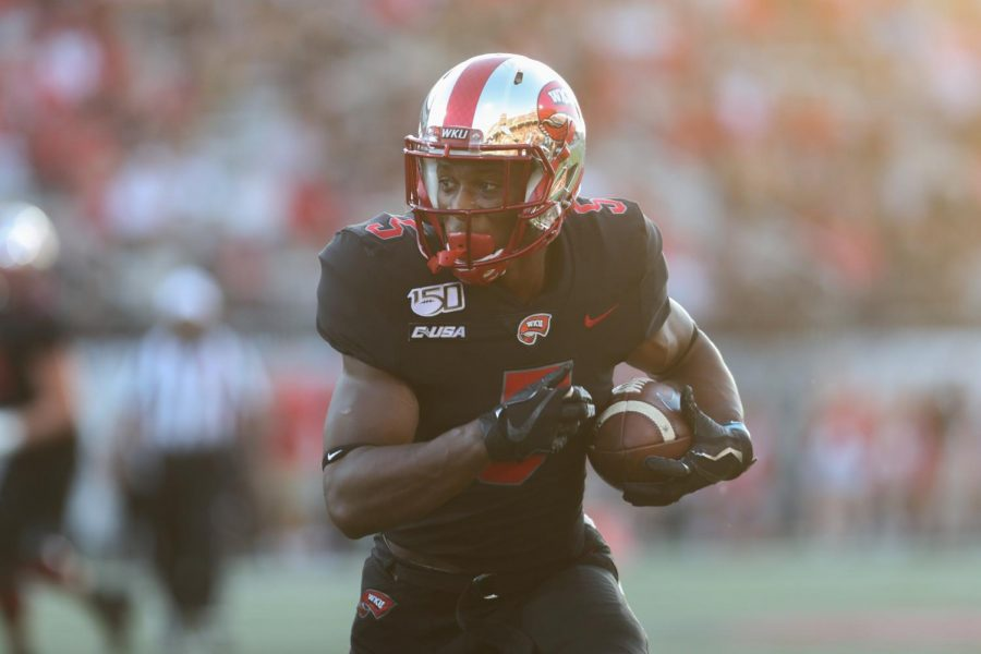 WKU+Hilltoppers+running+back+Gaej+Walker+%285%29+runs+the+ball+during+the+35-28+loss+to+the+Central+Arkansas+Bears+in+Houchens+Smith+Stadium+on+August+29%2C+2019.+Walker+scored+two+touchdowns+during+the+game.