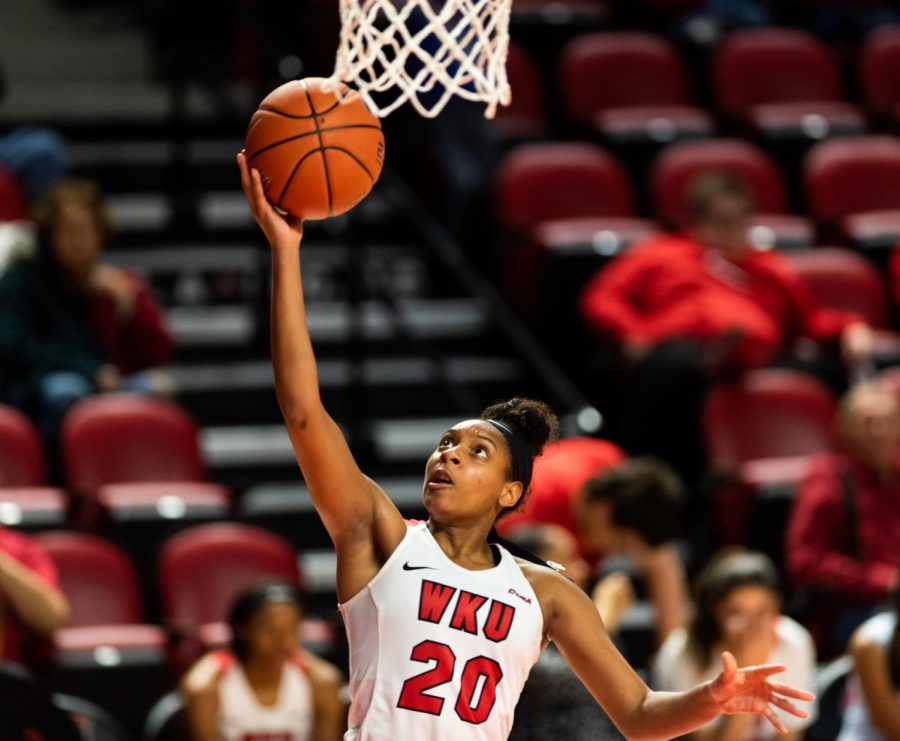 WKU guard Terri Smith (20) shoots a layup during the women's basketball game against Morgan State in Diddle Arena on Wednesday. WKU won 90-43.