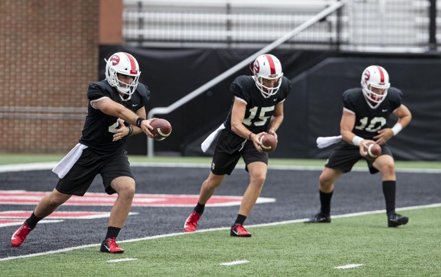 Ty Storey (4) practices with the WKU quarterbacks during WKU football practice on Monday, Aug. 26, 2019 at Houchens-Smith Stadium.