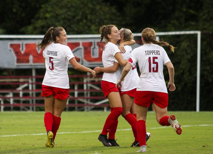 The WKU soccer team celebrates scoring a goal against Belmont during the season opener at the WKU Soccer Complex on Thursday, Aug. 22, 2019.