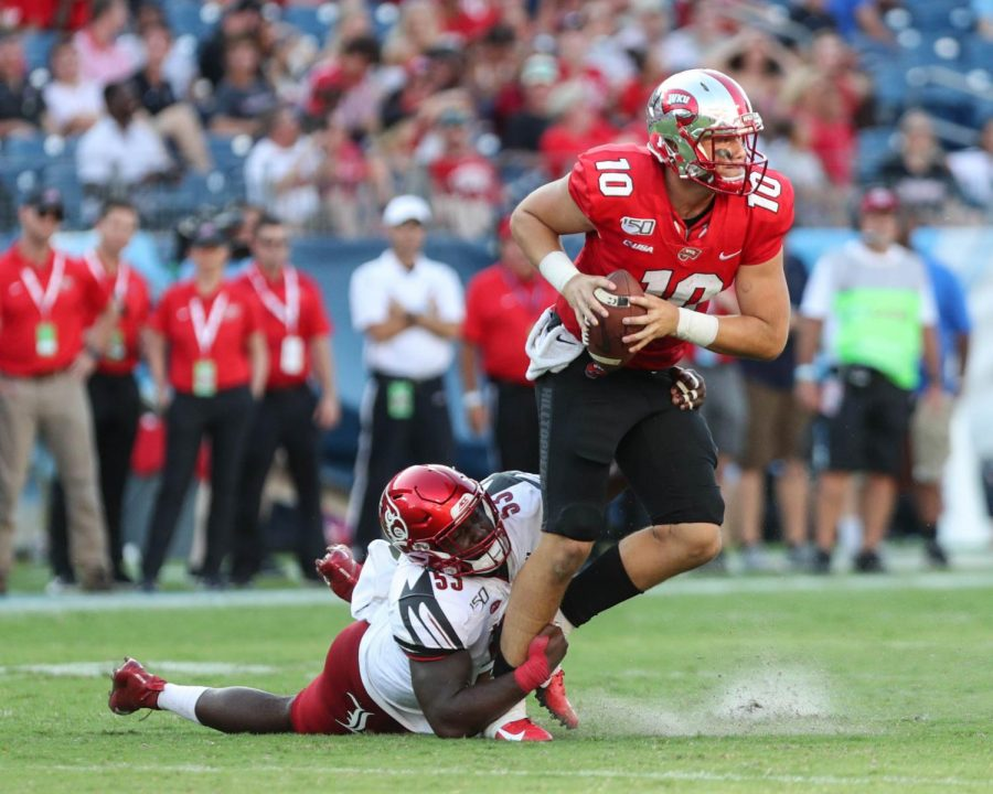 WKU+Hilltoppers+quarterback+Steven+Duncan+%2810%29+attempts+to+run+downfield+with+the+ball+before+being+sacked+by+Louisville+Cardinals+defensive+lineman+Amonte+Caban+%2853%29+during+their+game+in+Nissan+Stadium+on+September+14%2C+2019+Fahad+Alotaibi%2FHERALD