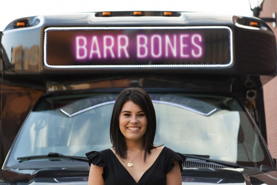 Carli Barr, owner of a newly operating traveling boutique, Barr Bones, stands in front for her van which operates as her store front which she has parked at the Bowling Green Hot Rods Stadium, Friday Sep. 20th 2019.
