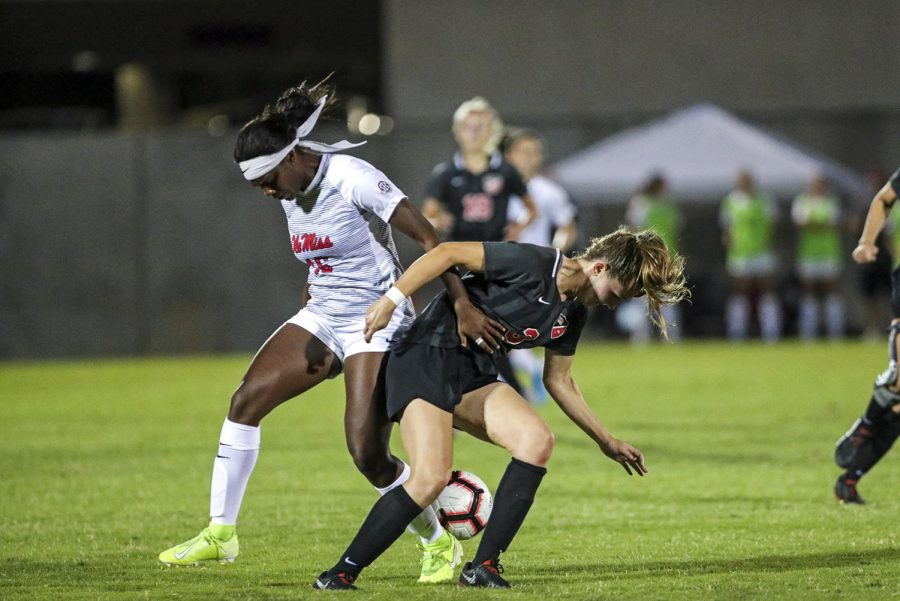 WKU defender Victoria Mayo (3) battles for the ball with Ole Miss forward Gabby Little (16).