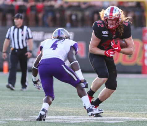 WKU Hilltoppers redshirt junior tight end Kyle Fourtenbary (42) attempts to pass before getting tackled by Central Arkansas Bears defensive back Juan Jackson (4) during WKU's loss 35-28 against Central Arkansas Bears in Houchens Smith Stadium on August 29, 2019.