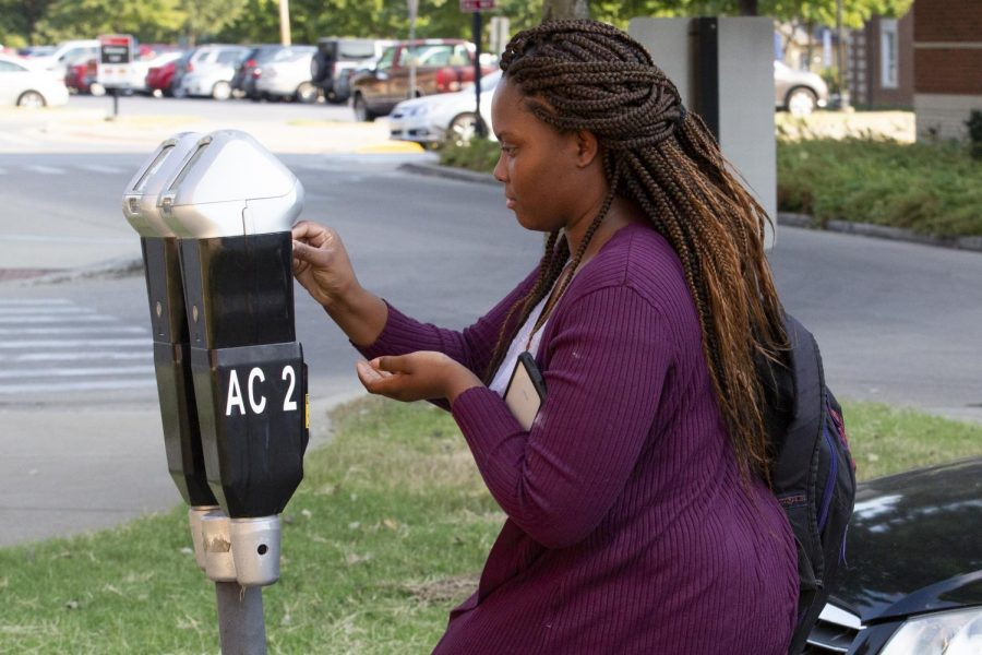 A patron feeds a parking meter next to Jody Richards Hall and the Academic Complex. The cost of parking meters rose to two dollars for 45 minutes and took effect at the beginning of the fall 2019 semester.