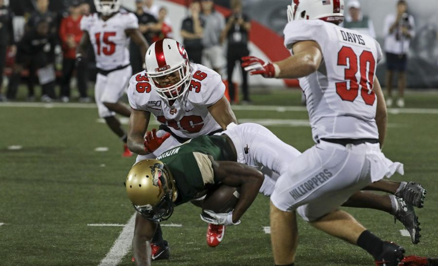 WKU linebacker Kyle Bailey (36) tackles UAB wide receiver Austin Watkins Jr. (6) while he runs with the ball during the first quarter of the game with Alabama-Birmingham in Houchens-Smith Stadium on Saturday Sept. 27, 2019.