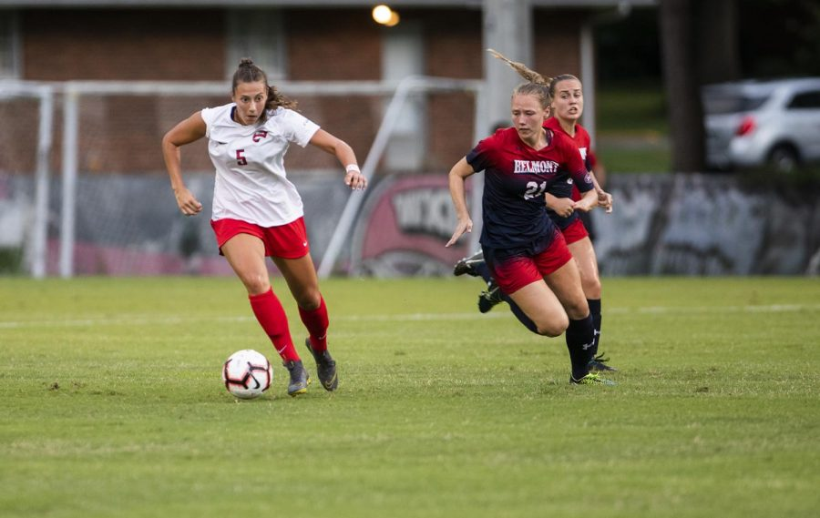 WKU forward Chandler Backes (5) dribbles the ball upfield against Belmont during the season opener at the WKU Soccer Complex on Thursday, Aug. 22, 2019.