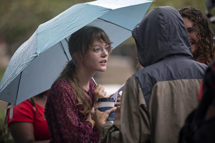 Climate strike organizer Jessica Williams speaks with fellow protesters during the demonstration in Centennial Mall on Sept. 26, 2019.