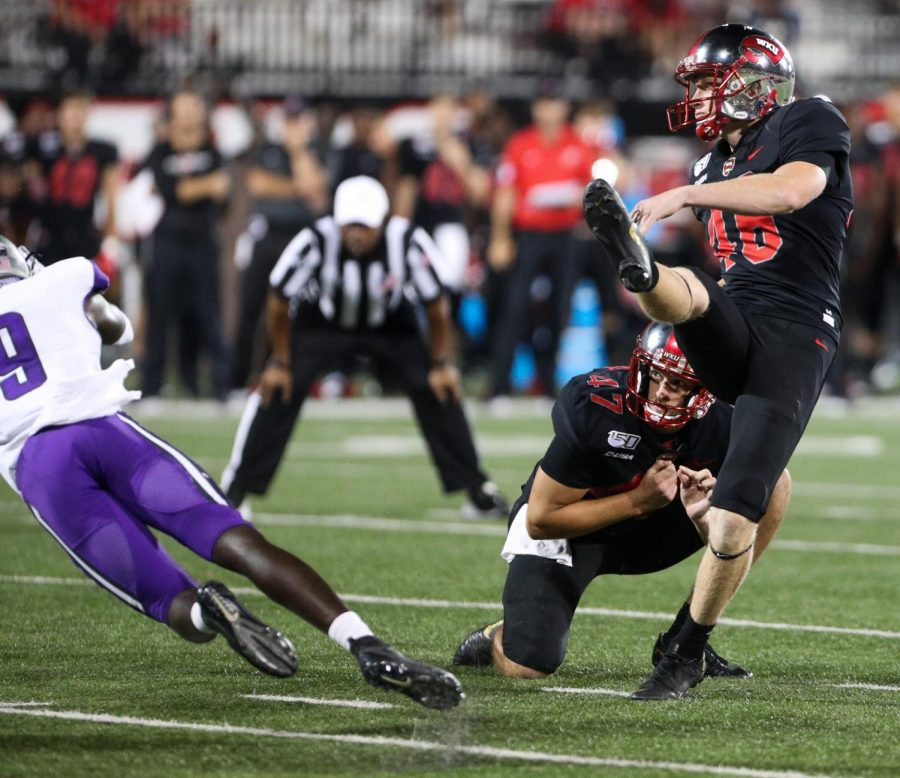 WKU Hilltoppers freshman kicker Cory Munson (46) launches a kick during WKU's 35-28 loss against the Central Arkansas Bears in Houchens-Smith Stadium on Thursday Aug. 29, 2019.