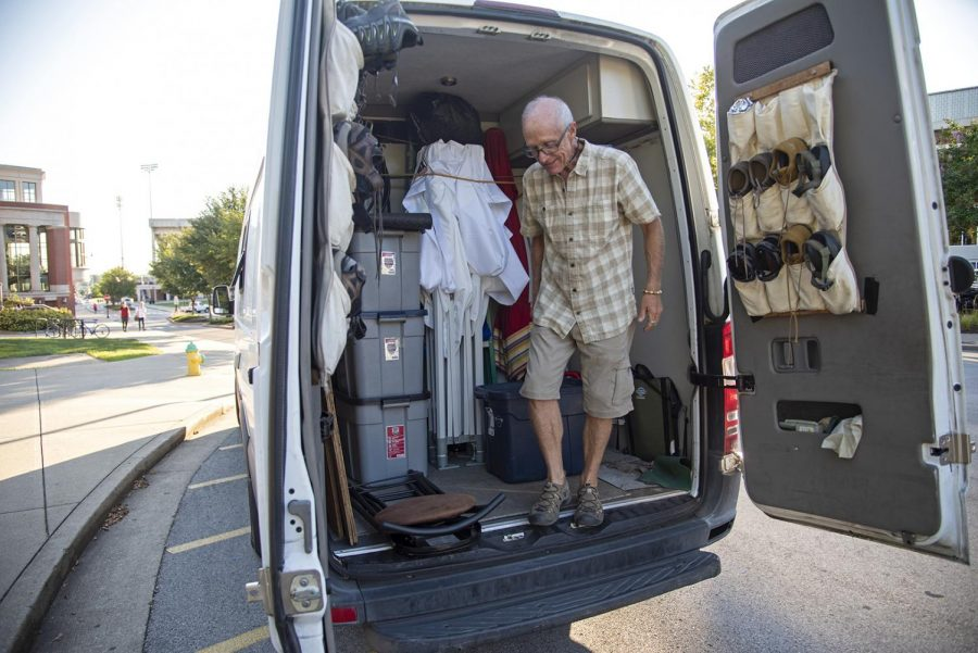 The back of the van Shakin lives in holds all of his inventory, his tent and his array of hiking shoes. He packs up at the end of each day and typically sleeps in his van only to set his shop back up in the morning.