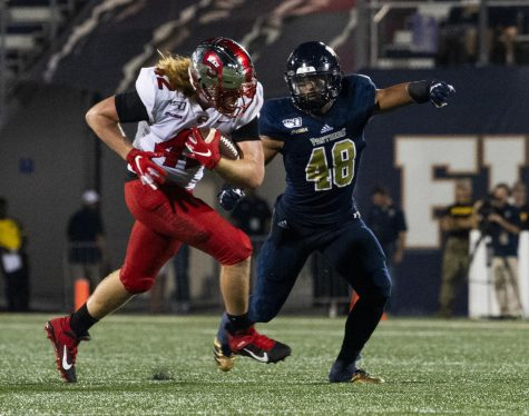 WKU tight end Kyle Fourtenbary (42) rushes the ball past FIU linebacker Josh Powell (48) in the Hilltoppers' 20-14 win at Riccardo Silva Stadium in Miami, Fla. on September 7, 2019.