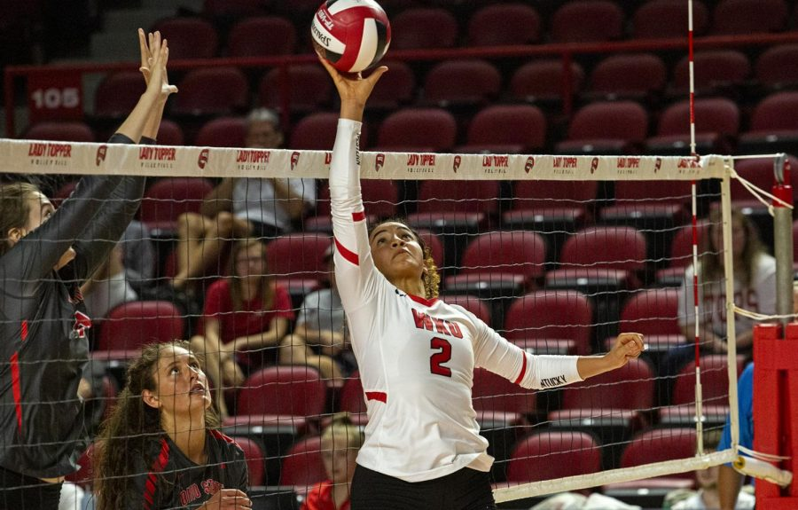 Nadia Dieudonne (2) taps the ball over the net in a win over Ohio State. WKU would later go 3-0 in the Holiday Inn University Plaza Invitational after a win against Tulane.