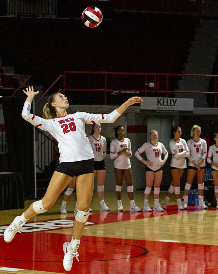 WKU's Kate Isenbarger (20) serves the ball to the opposing Ohio State team during a home game on Friday, Sept. 13, 2019.