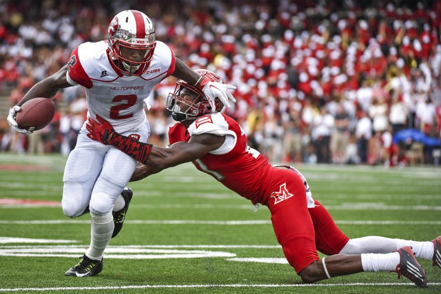 WKU's wide receiver Taywan Taylor (2) tries to get around University of Miami (Ohio) defensive back Marshall Taylor (21) during the Hilltoppers' 56-14 win against the University of Miami (Ohio) on Sept. 26, 2015 at Smith Stadium. Harrison Hill/HERALD