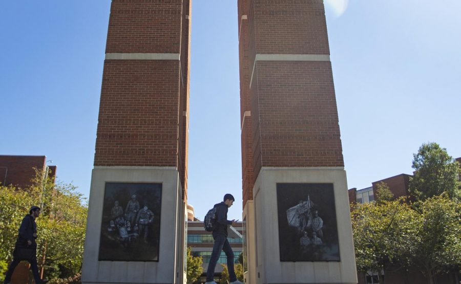 Students pass under Guthrie Bell Tower on October 18, 2019.
