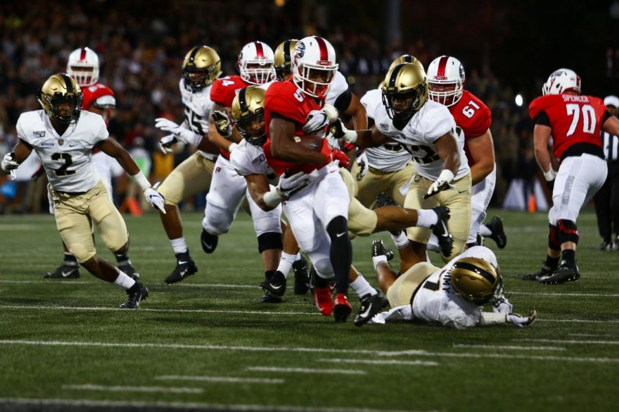 WKU running back Gaej Walker (5) marches through defenders before being stopped short of the goal line. WKU defeated the Army Black Knights 17-8 in Houchens-Smith Stadium on Saturday, Oct. 12, 2019.