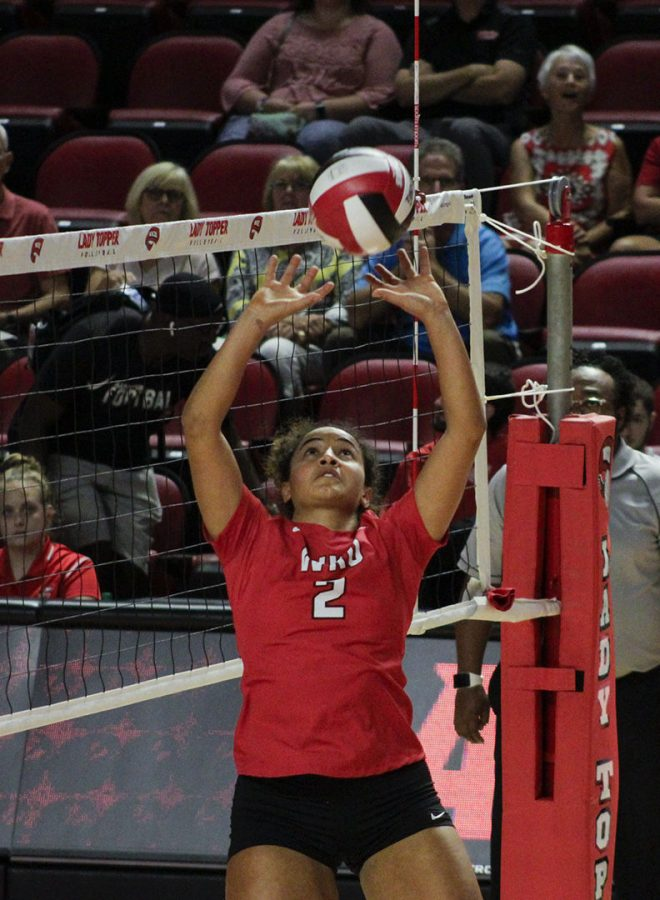 WKU+setter+Nadia+Dieudonne+%282%29+sets+the+ball+to+a+teammate+for+a+spike+during+the+match+with+Southern+Miss+in+Diddle+Arena+Sunday%2C+Sept.+29+2019.